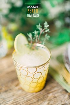 Pretty Peach Lemonade - 2 ounces peach flavored vodka such as Absolut, A Peach, 1 1/2 cups sugar, 1 cup hot water, 2 1/2 cups fresh squeezed lemon juice, 1 cup fresh peach juice or puree, 3/4 gallon cold water, thyme to garnish