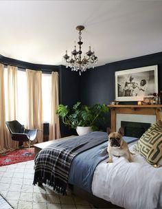 Farrow & Ball's Railings (31) feels like a warm hug in designer Danielle Nicholas Bryk and her husband Greg's principal bedroom.   Photographer: Alex Lukey