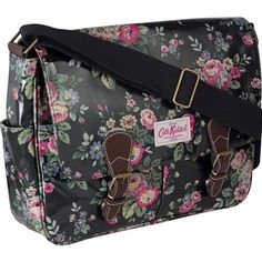 Our saddle bags are something of a staple with their practical design and plentiful pockets. Made using our durable oilcloth and completed with leather trims, they are easy to care for and their adjustable strap means they can be used as a shoulder or cross body bag. This design features our beautiful Trailing Floral print on a practical charcoal background.