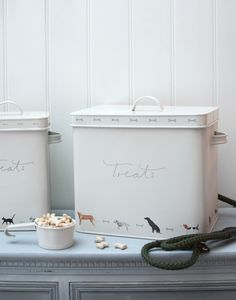 Dog Treat Tin - Woof! | Sophie Allport | Our Pet Tin is a practical addition to your kitchen or utility room. The perfect storage solution for your dog's dry food or treats.This stylish metal storage tin comes with a handy scoop.  A lovely gift for your cherished pet it features a range of goregous dog breeds illustrated by Sophie: Dalmation, black Labrador, Fox Red Labrador, Jack Russell, Terrier, Pugg, Pointer, Scottie, Springer Spaniel, Cocker Spaniel and Datschund.