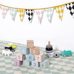 £30.00 We love the light colours, patterns and detail of these beautiful wooden blocks. Let's face it, wooden blocks end up everywhere around the living room, so why not have the prettiest ones out there! Each block has a pattern on it, representing the number displayed. Great for counting, stacking, building, and simply packing and unpacking. These are suitable from 12 months and great for fine motor skill development.