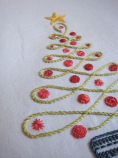 Christmas Tree - napkin ideas. Could be a great craft with my SDC kiddos!  Draw the lines and give them the glue, yarn, and maybe buttons!