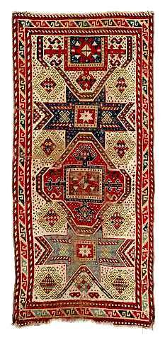 Gendge Star-Kasak 19th c An Eastern Caucasian rug with Star-Kasak design, probably GENDJE-AREA, 19th ct., formerly Kirchheim Collection, damages due to age, tiny hole, worn spots. Size 260 x 126 cm