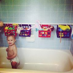 suspend a second rod along the edge of the tub. Use it to hang toy baskets.