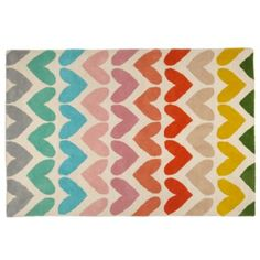 Look, it's time for us to have a serious conversation.  This colorful heart rug is a great way to add a bit of color into any room of your home.  Plus, it's hand tufted and made of 100% wool. Details, details Rug is hand tufted and cut Imported Click to see Rug GuideShow 'em what you're made of Pile: 100% Wool Backing: 70% Cotton, 21% Polyester, 9% RayonCare instructions Professional cleaning recommendedExtras! Extras! Don't forget an eco-friendly rug pad (sold separately).