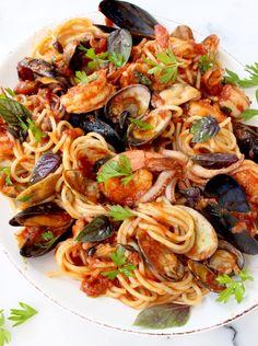 The ultimate seafood spaghetti recipe or Spaghetti Frutti di Mare, made with baby clams, mussels, squid & shrimp in a thick red tomato sauce. | CiaoFlorentina.com @CiaoFlorentina @RaguSauce #ad