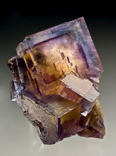 Unique and stunning specimen of Fluorite.An amber yellow core is surrounded by a purple zone followed by sea-blue outer layer. Minerva #1 Mine, Illinois