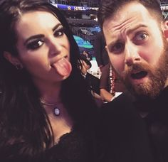 "WWE Diva Paige and her boyfriend Kevin Skaff at the WWE Hall of Fame Ceremony. She went ""anti glam"" by pairing Doc Martens with her black evening gown."