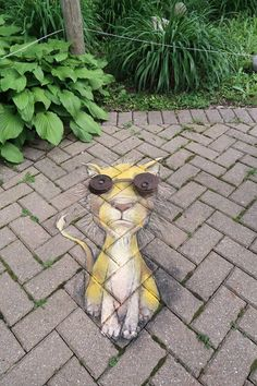 David Zinn 2017. Many thanks to Art & About in Saginaw for making this awkwardly goggled feline possible. — at Children's Zoo at Celebration Square, Michigan