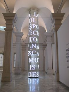 "Jenny Holzer, ""For SAAM,"" 2007, a time-based media sculpture comprised of vertical strands of white LEDs that reveal different text and patterns over a 24 hour cycle, located at the Smithsonian Museum of American Art."