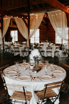 Curtains and cafe lights are a great way to add elegance to a rustic space | Image by Melissa Marshall Photography