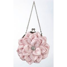 Standing 7 tall, this pink satin purse is perfect for carrying your wedding day essentials. The pink satin purse is shaped as a flower and touched off with a silver rhinestone decoration