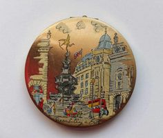 Stratton compact.  Piccadilly Circus