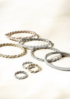 Wisteria bracelets and rings with diamonds.