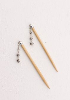 "Hair sticks with ornamental silver bead dangle - Includes two 5"" blonde sticks Simply Charming Shop LillaRose for accessories for all types of hair & lengths! Hair clips, hair band, hair pins & more! Shop and/or become a consultant! Enjoy! www.lillarose.biz/SimplyCharming"