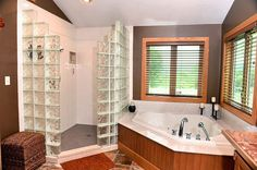 Master bedroom with walk-in glass block shower and whirlpool tub.
