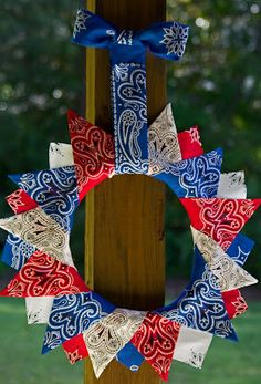 Patriotic Wreath - Idea from Life in Wonderland.  She hot glued bandanas to a wooden wreath.  This site is full of wonderful ideas for different occasions.  It's really worth taking the time to visit.