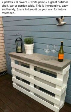 Two pallets, three pavers and some white paint makes a great outdoor shelf or table.