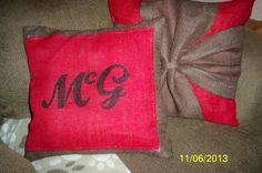 monogrammed burlap throw pillow I made..behind it is the ribbon wrapped pillow I did awhile back =)