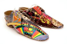 A set of cardboard shoes made from beer crate cardboard, record sleeves and found cardboard.