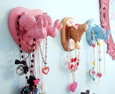 Spray paint plastic animals from the Dollar Store and glue to wooden boards. Cute DIY project for little girls room. That's an awesome easy idea!!