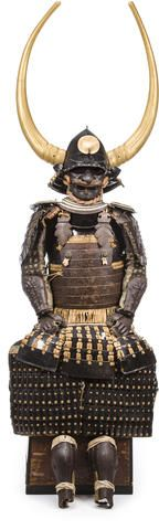 A russet iron armor with impressive helmet Edo period (18th century), the helmet later Component parts laced in doe skin and comprising a later black-lacquer momonari kabuto with old three lame hineno-style shikoro, gold lacquer disk maedate and large gold-lacquer water-buffalo horns wakidate;