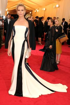 Charlize Theron in Dior black cape black and white swirl