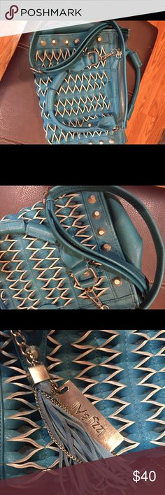 Izzy and Ali teal cross body bag Izzy and Ali woven teal vegan leather crossbody bad with studs izzy and Ali Bags Crossbody Bags
