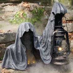 Provoke some disturbed double-takes when your guests spot our ghastly Ground Reaper Statue.Grandin Road Ground Reaper Statue Appearing to emerge from a stone walkway or wall, this hooded specter has a weathered, time-worn appearance, and can be illum Casa Halloween, Halloween Tags, Halloween Displays, Outdoor Halloween, Halloween Projects, Holidays Halloween, Creepy Halloween, Halloween Halloween, Vintage Halloween