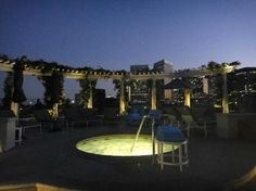 rooftop pool with jacuzzi at night