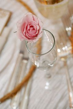 spray rose on each champagne glass