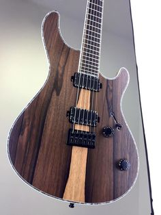 """Mayones Guitars And Basses.  Custom Shop, Green Ebony (Jacaranda) top, Trans Natural Matt finish, Black Korina body wings, 11-ply 'Exotic II' neck-thru-body section, Green Ebony fingerboard, 16"""" fingerboard radius, 25.4"""" scale, 24 Ferd Wagner jumbo frets, only side dot markers, 3-ply White ABS / Gray Acrylic Pearl binding, Bare Knuckle Pickups Black Dog Black Battleworn cover humbucker set, Electroswitch Electronic Products 3-way slide pickup selector, Volume (push-pull for coil splitting)"""