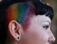 Julia Gill, sporting a rainbow haircut, waits to march in a gay pride parade in Salt Lake City, Utah. Over 300 active Mormons and more than 5,000 members of the Lesbian, Gay, Bisexual and Transgender (LGBT) community with their supporters marched in the parade as part of the Utah Pride Festival.
