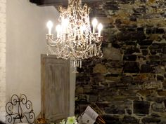 cafe in Varenna, Italy... love the old stone walls and chandelier...