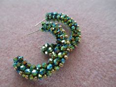This week, Kelly from Off the Beaded Path, in Forest City, North Carolina brings you a another great project. Kelly shows you how to make a beautiful pair of...