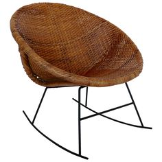 Calif Asia Iron and Rattan Rocker | From a unique collection of antique and modern rocking chairs at https://www.1stdibs.com/furniture/seating/rocking-chairs/