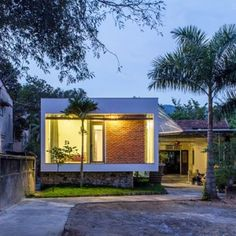 Nha4 Architects adds flood-proof extension to family home in Vietnam. Tropical Architecture.