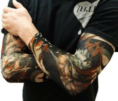"""Tattoo Sleeves - Vicious Wolf Fake Tattoo Sleeves (Pair) #39 by BeWild. $9.99. Tattoo Sleeves - Vicious Wolf Fake Tattoo Sleeves (Pair). Hot new amazing item, temporary slip on body art. Amaze your boss, your wife, your friends with our new temporary tattoo sleeves. Now you can get """"inked"""" by night and still keep your day job with our amazingly cool """"tattoo sleeves"""" the tattoo is printed directly on the sleeves fabric which is a machine washable nylon. They come in pairs; wear on..."""