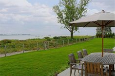This home offers 270 degrees of water front views and 360 feet of beach front access. Westport, CT Coldwell Banker Residential Brokerage