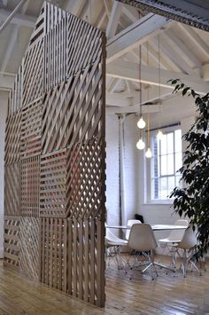 For a meeting space for a creative agency in Shoreditch, East London, Richard Shed and An Michiels devised a patchwork white oak lattice room divider.