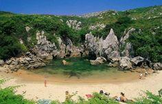 10 Unique Beaches... #8 Playa de Gulpiyuri, Asturias, Spain An inland beach with a cove and caves