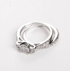 I would love this as an engagement ring but switch the middle diamond to a pearl!