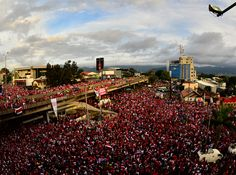 Ticos (as Costa Ricans like to be called) have a very close relationship with the National Soccer Team. Here we see a multitude celebrating a big win during the FIFA 2014 World Cup.