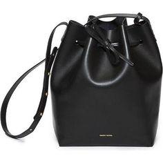 Alessandra Ambrosio wearing Mansur Gavriel Bucket Bag.