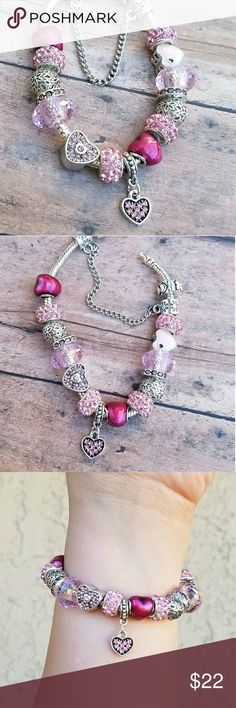 Pink & Fushia Heart Love Charm Bracelet Handmade by me on a charm on 925 sterling silver barrel clasp snake bracelet. Includes a safety chain to ensure charms don't slip off, micro fiber care cloth and black velvet jewelry bag.   Bracelets are made to order. Please select your preferred bracelet size: 7.5, 7.75 or 8.25 inches. Jewelry Bracelets