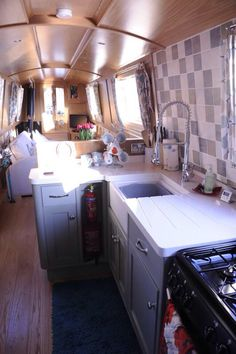 Painted kitchen cupboards in narrowboat kitchen