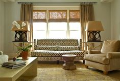 Janie Molster Designs - living rooms - Kelly Wearstler Imperial Trellis - Parchment/Midnight, Currey & Co. Harewood Bench, sofa, carved, wood, hourglass, stool, camel, velvet, rolled-arm, chair, iron, lamps, tan, linen, drapes, bamboo, roman shades, yellow, brown, Oriental, rug, gray, walls, sofa in front of windows, imperial trellis sofa,