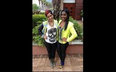 Ebony.com: Neyo's protégée RaVaughn poses with Superstar Nail Lacquer Owner Ari Pierce and makes grunge look girly in her skull T-shirt, printed jacket, and combat boots.