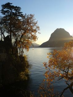 Autumn in Ticino: The panoramic mountain San Salvatore with Lago Maggiore in the light of the setting sun.