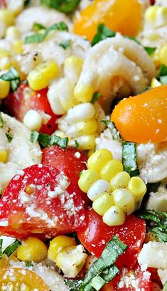 Tortellini Pasta Salad with Tomatoes, Basil and Fresh Corn ~ This delicious tortellini pasta salad — studded with bright, juicy tomatoes, fresh sweet corn, and ribbons of basil — is sure to become your favorite summer side dish or light supper!